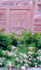 Town Seal Above A Bed Of Flowers